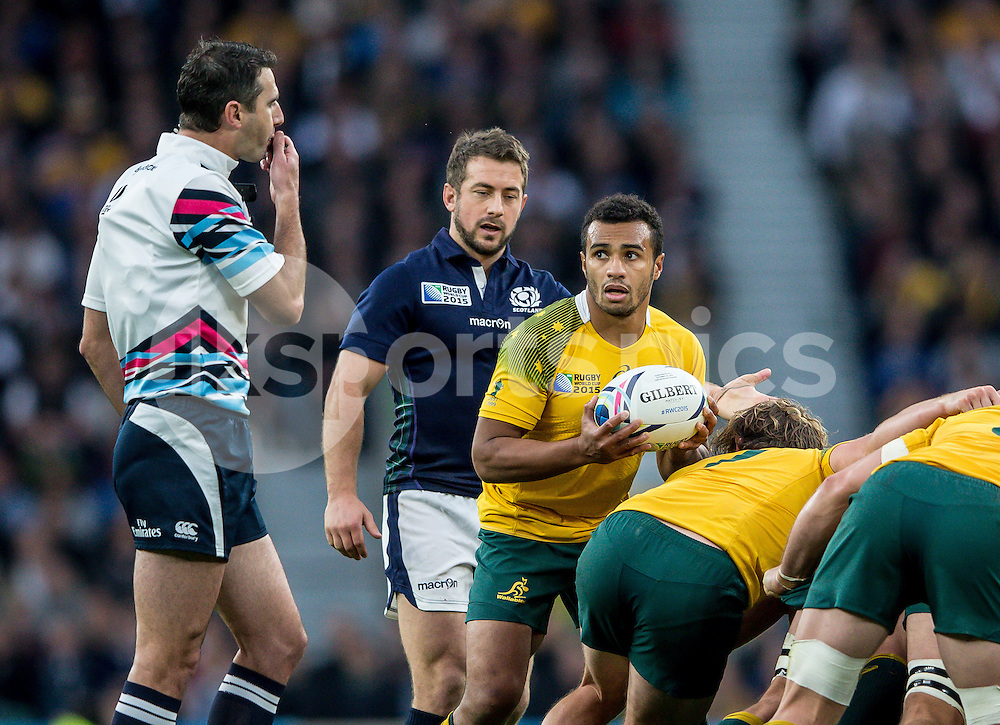 Will Genia of Australia looks on at Referee Craig Joubert (South Africa) during the Rugby World Cup Quarter Final match between Australia and Scotland played at Twickenham Stadium, London on the 18th of October 2015. Photo by Liam McAvoy.