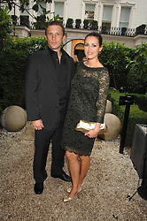 TV presenter KIRSTY GALLAGHER and PAUL SAMPSON at an evening with racing driver Lewis Hamilton held at The Hempel Hotel, 31-35 Craven Hill Gardens, London W2 on 4th July 2007.<br /><br />NON EXCLUSIVE - WORLD RIGHTS