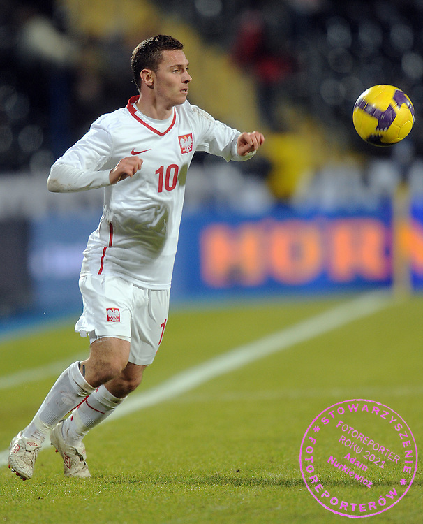 LUDOVIC OBRANIAC (POLAND) CONTROLS THE BALL DURING FRIENDLY SOCCER MATCH BETWEEN POLAND AND CANADA IN BYDGOSZCZ , POLAND...POLAND , BYDGOSZCZ , NOVEMBER 18, 2009..( PHOTO BY ADAM NURKIEWICZ / MEDIASPORT )..PICTURE ALSO AVAIBLE IN RAW OR TIFF FORMAT ON SPECIAL REQUEST.