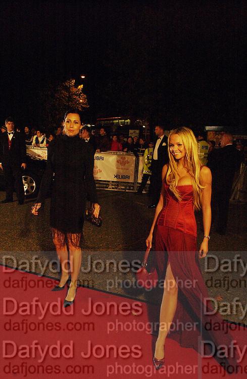 Minnie Driver and Jennifer Ellison, Fashion Rocks in aid of the Princes trust, royal albert Hall, 15  october 2003.   © Copyright Photograph by Dafydd Jones 66 Stockwell Park Rd. London SW9 0DA Tel 020 7733 0108 www.dafjones.com
