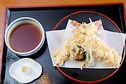 Tempura made by prawns, shiitake mushroom and green chili. Served together with grated daikon radish and grated fresh ginger and a tempura sauce. The Sarashina Horii Restaurant. Tokyo, Japan.