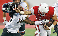 Nov 7, 2015; Houston, TX, USA;  Houston Cougars running back Kenneth Farrow (35) stiff arms Cincinnati Bearcats cornerback Leviticus Payne (9) and knocks off his helmet in the third quarter at TDECU Stadium. Houston won 33 to 30. Mandatory Credit: Thomas B. Shea-USA TODAY Sports