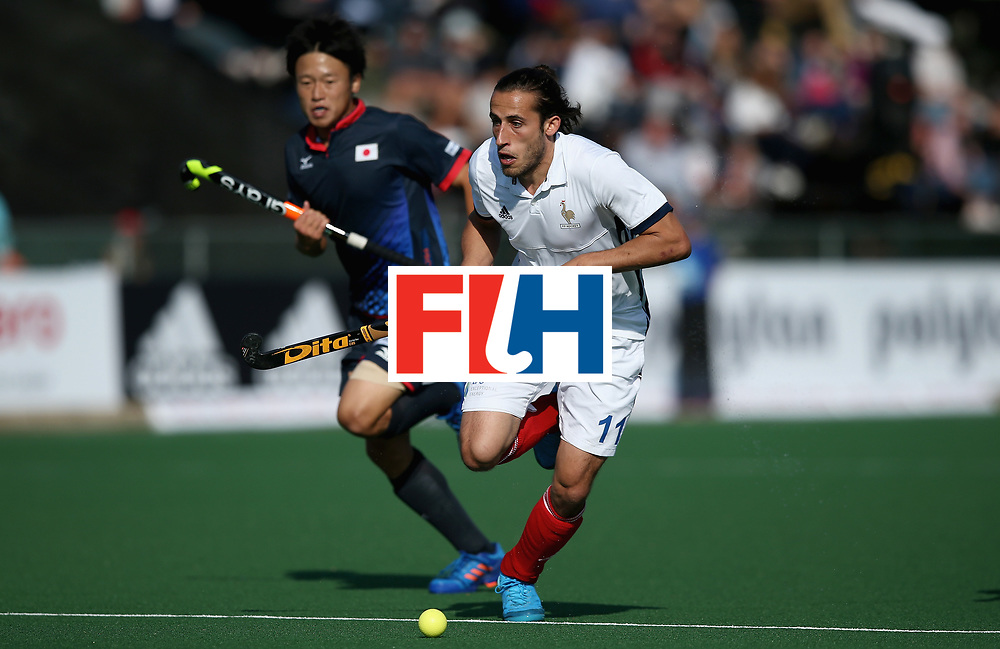 JOHANNESBURG, SOUTH AFRICA - JULY 13:  Charles Masson of France and Seren Tanaka of Japan battle for possession during day 3 of the FIH Hockey World League Semi Finals Pool A match between Japan and France at Wits University on July 13, 2017 in Johannesburg, South Africa.  (Photo by Jan Kruger/Getty Images for FIH)