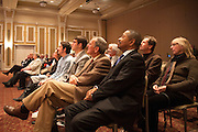 Fellow colleages and friends of Dr. Christopher France listen as he lectures during the Distinguished Professor Portrait Unveiling and Lecture in Baker University Ballroom on Tuesday, March 10.