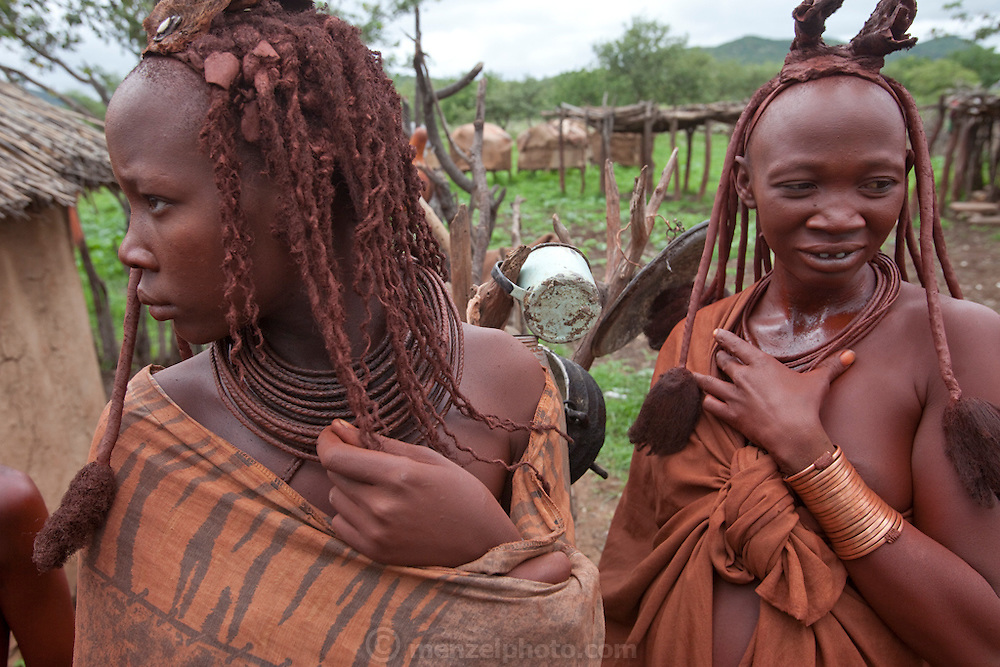Himba tribespeople in the small village of Okapembambu in northwestern Namibia, during the rainy season in March. The Himba diet consists of corn meal porridge and sour cow's milk.