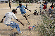 Haitian children soccer in  Port au Prince, Haiti February 3, 2006. Whichever of the 35 candidates running for president wins the February 7 election will inherit a nation where the majority of the population lives below the poverty line with minimal health care..Photo by Keith Bedford