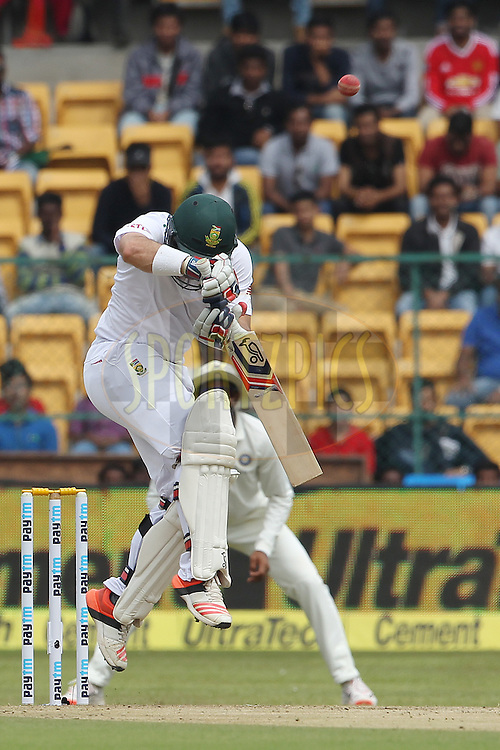 Dean Elgar of South Africa is hit by a delivery from Varun Aaron of India  during day one of the 2nd Paytm Freedom Trophy Series Test Match between India and South Africa held at the M. Chinnaswamy Stadium in Bengaluru, India on the 14th November 2015<br /> <br /> Photo by Ron Gaunt  / BCCI / SPORTZPICS