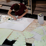 Technical crew work on Aurora in Factory Settings workshop weeks before the bear will walk the streets of London. Aurora is a giant polar bear puppet, the size of a London double decker bus. The bear is the brain child of Greenpeace UK and it will be the center piece in the Greenpeace campaign Save the Arctic  global day of action in London Sept 15th. Aurora is designed by Christopher Kelly in collaboration with props designer Simon Costin and made by Factory Settings in East London.