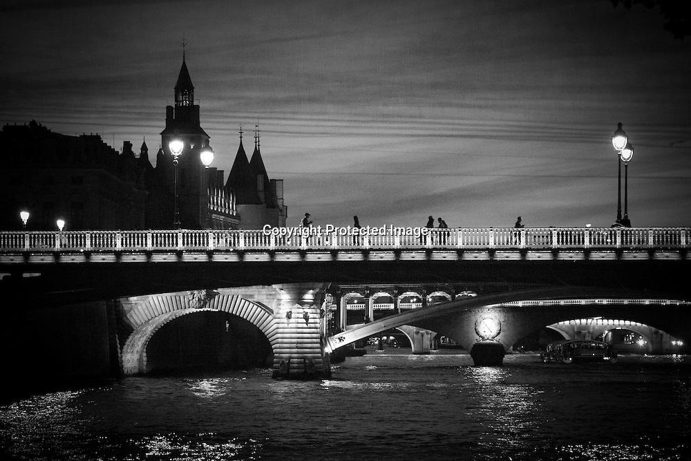 France. Paris. 1st district. the Arcole bridge .  Ile de la Cite, Paris, France. The spires of the Conciergerie rise above the Seine in Paris / Le clocher de la  conciergerie, la seine.