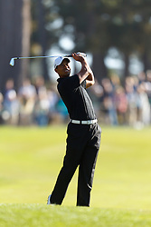 Feb 10, 2012; Pebble Beach CA, USA; Tiger Woods hits his second shot on the first hole during the second round of the AT&T Pebble Beach Pro-Am at Monterey Peninsula Country Club. Mandatory Credit: Jason O. Watson-US PRESSWIRE