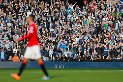 Manchester City fans wave Chris Smalling of Manchester United off the pitch after is shown a red card by referee Michael Oliver - Photo mandatory by-line: Rogan Thomson/JMP - 07966 386802 - 02/11/2014 - SPORT - FOOTBALL - Manchester, England - Etihad Stadium - Manchester City v Manchester United - Barclays Premier League.