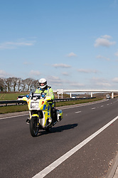 Traffic police officer on patrol, Sussex