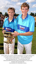 Left to right, polo player s MARK TOMLINSON and LUKE TOMLINSON, at a polo match in West Sussex on 20th July 2003.PLP 469