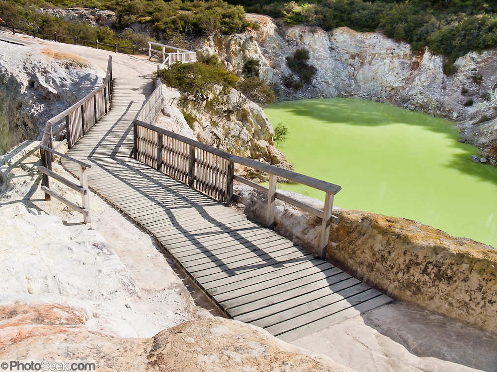 Devil's Bath gets its color from excess water from Champagne pool mixing with sulphur and ferrous salts. Changes in color from green to yellow depend upon cloud cover and reflected light. Wai-O-Tapu Thermal Wonderland, North Island, New Zealand