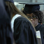 A Goldey-Beacom College Student reads a ceremonial  program during Goldey-Beacom commencement exercise Friday, May 1, 2015, at Joseph West Jones College Center on the campus of Goldey-Beacom College in Wilmington Delaware.
