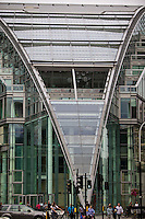 Architectural details of the building of Victoria railway station in London, Great Britain. Daylight view onto shape of glass walls and entrance.
