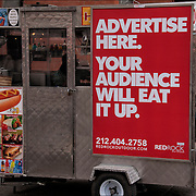 "Humorous sign on back of Hot Dog Stand ""Advertise Here -Your Audience Will Eat it Up"""