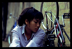 Portrait of a young Vietnamese woman waiting for her bicycle to be repaired, Lang Son, Vietnam, Southeast Asia, 1997