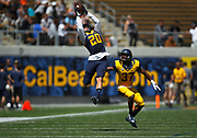 California Golden Bears running back Jeffrey Coprich (20) makes a reception against California Golden Bears cornerback Cedric Dozier (37) during a football scrimmage, Saturday, April 18, 2015, at the California Memorial Stadium in Berkeley, Calif.