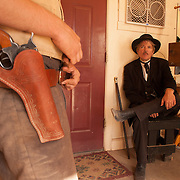 Actors take a break backstage between re-enactments of the infamous gunfight at the OK Corral in Tombstone, Arizona. In background, in black: James Robert (as Morgan Earp).