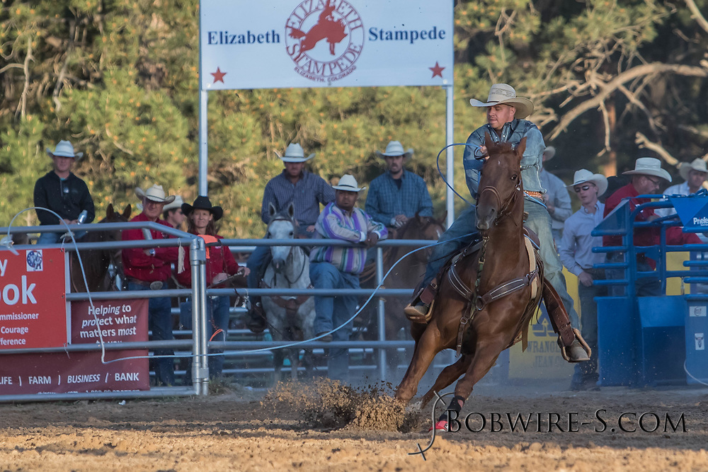 Header Eric Martin and heeler Cody Huwa make their team roping run during the second performance of the Elizabeth Stampede on Saturday, June 2, 2018.