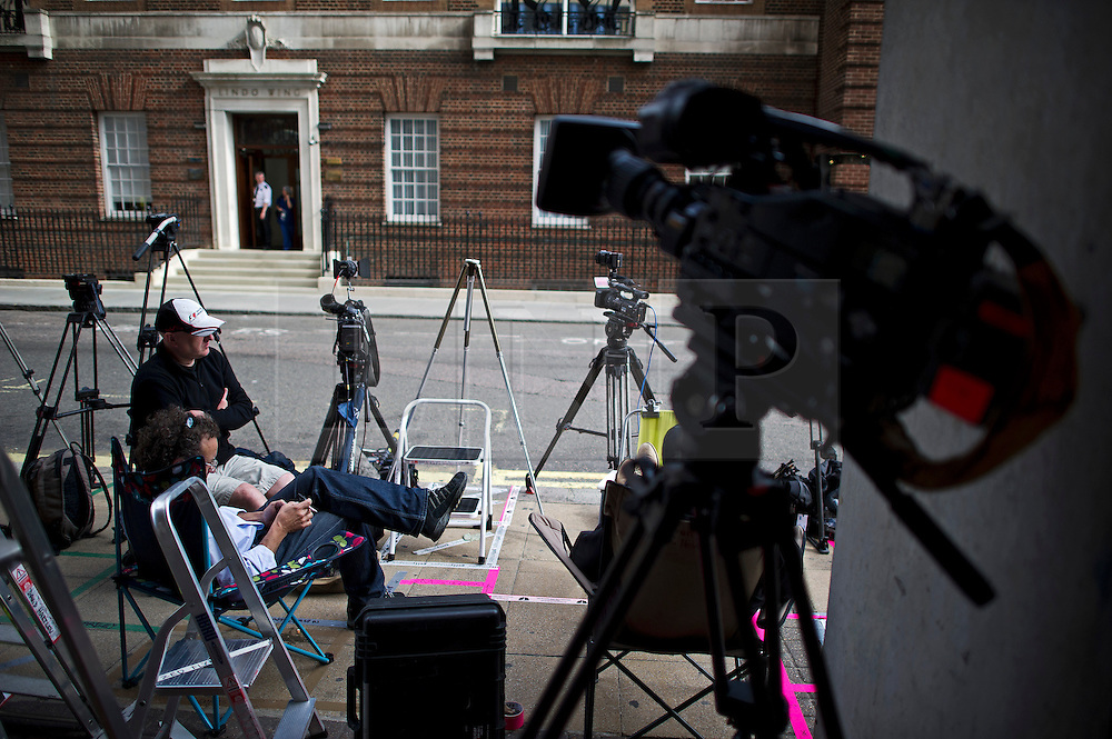 © London News Pictures. 01/07/2013. London, UK.  Members of the media begin to mark positions and gather outside an entrance to St Mary's Hospital in Paddington, London where Prince William and the Duchess of Cambridge are due to hold a photocall following the birth of their baby which is due in mid July. . Photo credit : Ben Cawthra/LNP