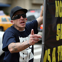 A Bible Believers member argues while protesting during the Republican National Convention in Tampa, Fla. on Wednesday, August 29, 2012. (AP Photo/Alex Menendez)