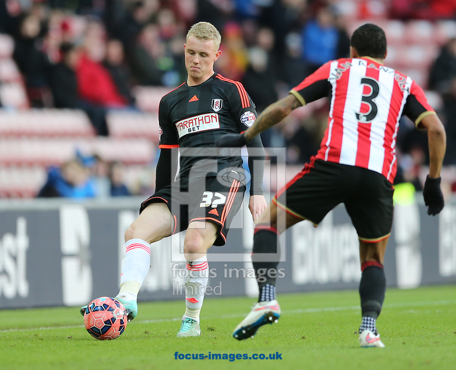 Patrick van Aanholt (r) of Sunderland and Jack Grimmer of Fulham during the FA Cup match at the Stadium Of Light, Sunderland<br /> Picture by Simon Moore/Focus Images Ltd 07807 671782<br /> 24/01/2015
