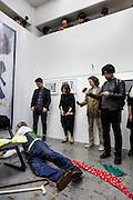 Kawasaki, November 29 2014 - Japanese artist Tatsumi ORIMOTO performing with ducks at Aoyama Meguro Gallery, Tokyo.