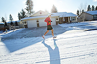 Keith Erickson runs through his neighborhood as he makes his way to Ramsey Road during a run Wednesday. Erickson has been running 80 miles a week for several weeks straight, writing about his secret to the hardcore training and the toll it takes.