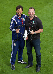 NEWPORT, WALES - Saturday, May 30, 2015: Wales' manager Chris Coleman with Drone company M7 during the Football Association of Wales' National Coaches Conference 2015 at Dragon Park. (Pic by David Rawcliffe/Propaganda)