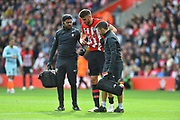 Wesley Hoedt (6) of Southampton limps off with an injury during the Premier League match between Southampton and Chelsea at the St Mary's Stadium, Southampton, England on 7 October 2018.