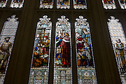 Stained glass images of important historic medieval figures from the City of London's history, seen in the Guildhall.