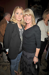 Left to right, BELLA BENSON and her mother INGRID SEWARD at a party to celebrate the publication of 'A Lion called Christian' held at 36 Chapel Street, London SW1 on 26th March 2009.