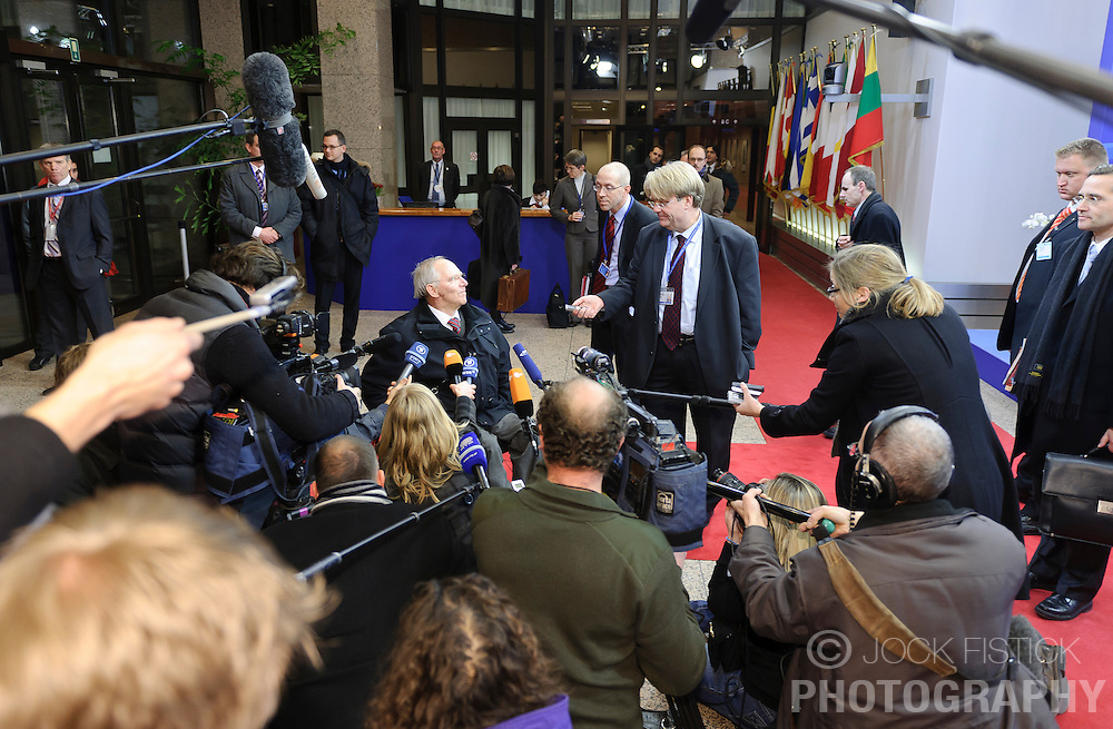 Wolfgang Schaeuble, Germany's finance minister, center, speaks to members of the press as he arrives for a Eurogroup meeting in Brussels, Monday Dec. 6, 2010.(Photo © Jock Fistick)
