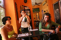 Carolina Vélez, the co-owner of Oh! Lá Lá, opens a bottle of champagne for guests at the small yet very popular restaurant in Cartagena, on Saturday, August 23, 2008. (Photo/Scott Dalton).