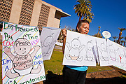 "07 FEBRUARY 2011 - PHOENIX, AZ: GEORGINA GRIVALJA, from Tucson, AZ, stands in support of birthright citizenship in front of the Arizona Capitol with a chain of hand drawn babies that represent ""anchor babies"" Monday, February 7. The Arizona State Legislature, led by the State Senate is debating the 14th Amendment, which would bar US citizenship for the children of undocumented immigrants born in the United States. The bill has broad support among Republicans, who are the majority party, in the state legislature but not among Democrats. The law is also very unpopular in the state's Latino and immigrant communities.       Photo by Jack Kurtz"