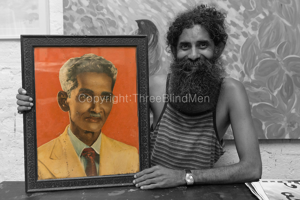 Anup Vega with a portrait of his grandfather, L.R.Z.J.
