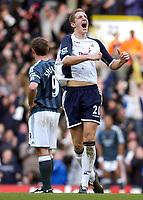 Photo: Daniel Hambury.<br />Tottenham Hotspur v Newcastle United. The Barclays Premiership. 31/12/2005.<br />Tottenham's Michael Dawson celebrates his sides second goal as Newcastle's Alan Shearer looks on gutted.