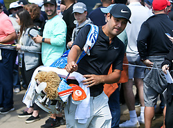 May 15, 2019 - Bethpage, New York, United States - Harry Diamond, caddie for Rory McIlroy, walks off the 16th green during a practice round at the 101st PGA Championship at Bethpage Black. (Credit Image: © Debby Wong/ZUMA Wire)