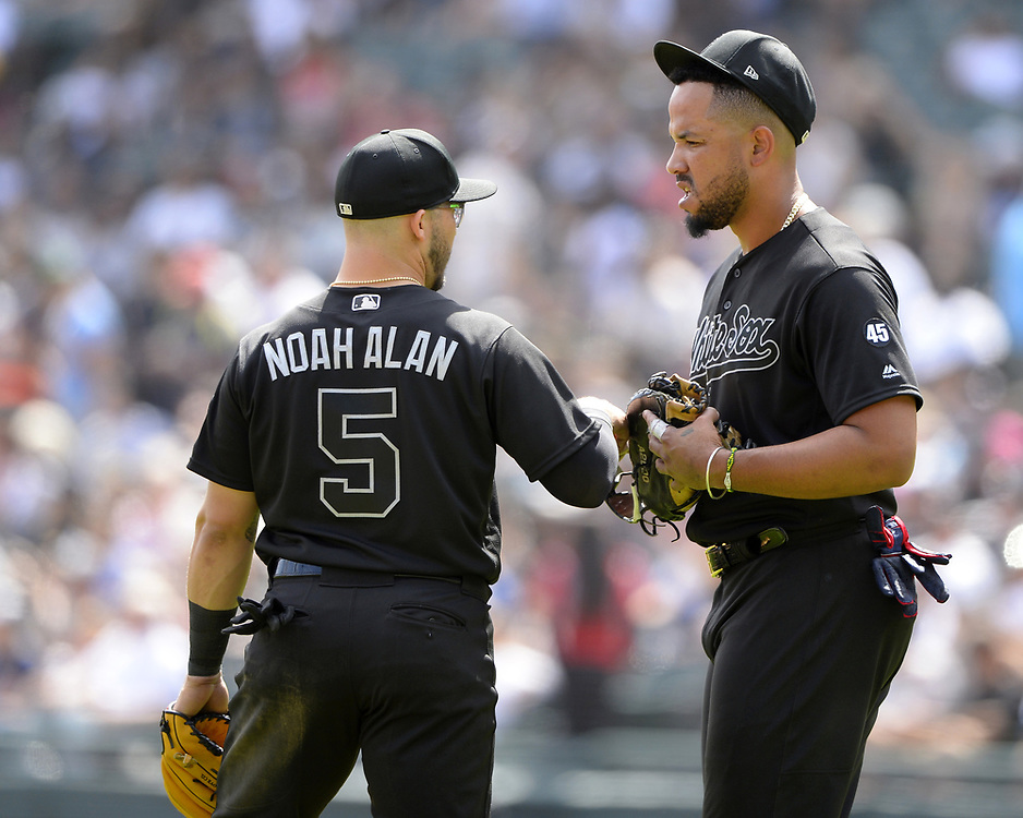 CHICAGO - AUGUST 25:  Jose Abreu #79 and Yolmer Sanchez #5 of the Chicago White Sox talk to each other against the Texas Rangers during Players Weekend on August  25, 2019 at Guaranteed Rate Field in Chicago, Illinois.  (Photo by Ron Vesely)  Subject:   Jose Abreu; Yolmer Sanchez