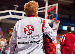 """A Poca fan stands on the court after winning the Class AA state championship with a shirt that reads, """"You're gonna win it all, I guarantee it."""" -Bryan Frampton"""