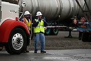 Workers prepare to back up a flatbed carrying two new transformers at the Robert Moses-Robert H. Saunders Dam in Massena on Wednesday, November 12, 2014.