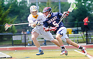 Springfield's Jack Crowther defends as Central Bucks East's Ryan Brown#5 drives towards the net in the third quarter during the PIAA lacrosse quarterfinal playoff at Harrison High School Saturday May 30, 2015 in Bryn Mawr, Pennsylvania. Springfield defeated Central Bucks East 8-3. (Photo by William Thomas Cain/Cain Images)