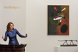 © Licensed to London News Pictures. 19/06/2018. LONDON, UK. Helena Newman, Chairman, Sotheby's Europe, manages bids for (top) ''Peinture'' by Joan Miró, (Est. £8,000,000 - 12,000,000) which failed to sell and (bottom) ''Le Chat'' by Alberto Giacometti, (Est. £10,000,000) which sold for a hammer price of £11,000,000 at Sotheby's Impressionist & Modern art evening sale in New Bond Street.  Photo credit: Stephen Chung/LNP