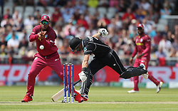 New Zealand's Ross Taylor makes his ground before West Indies Shimron Hetmyer can remove the bails during the ICC Cricket World Cup group stage match at Old Trafford, Manchester.