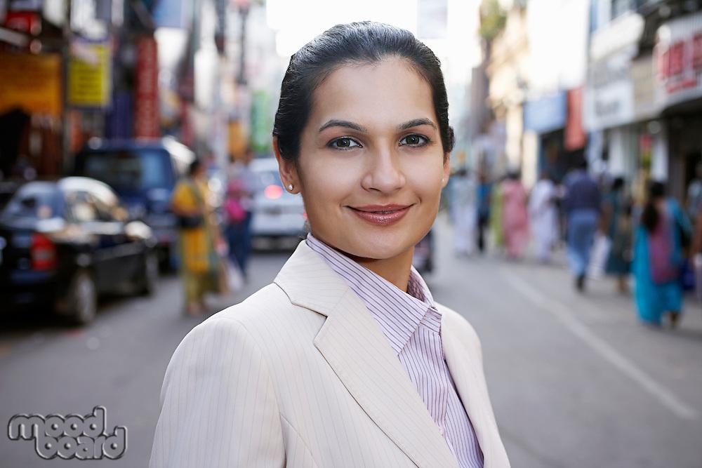 Portrait of business woman on city street