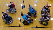 Left to Right, Donny Owen, Ryan Sewell, Jodi Krause, Josh Becker, Dale Smerglia, and Shawn Vogelgesang anticipate the ball's direction in front of the goal line during the 5th annual Quad Rugby event in the Charles J. Ping Recreation Center on September 15, 2012.
