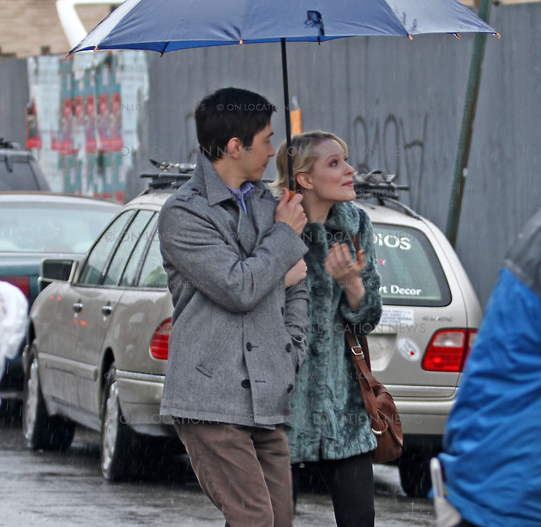 """Justin Long and Evan Rachel Wood on the rainy set of """"A Case of You"""" in Brooklyn, New York. February 16th 2012 Non Exclusive. Photo Sales Contact: Eric Ford/ On Location News 1/818-613-3955 info@onlocationnews.co"""