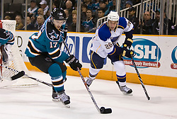 January 6, 2010; San Jose, CA, USA; San Jose Sharks center Torrey Mitchell (17) keeps the puck from St. Louis Blues right wing B.J. Crombeen (26) during the first period at HP Pavilion. San Jose defeated St. Louis 2-1 in overtime. Mandatory Credit: Jason O. Watson / US PRESSWIRE